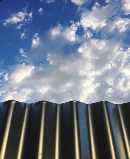 Aluminum wall leading towards the sky. Aluminum Wall Leading Towards Sky Skyline Grooves Raffled Blue Silver  White Cloud - Sky Day No People Outdoors Low Angle View Sunlight Close-up Architecture Nature Golden Section
