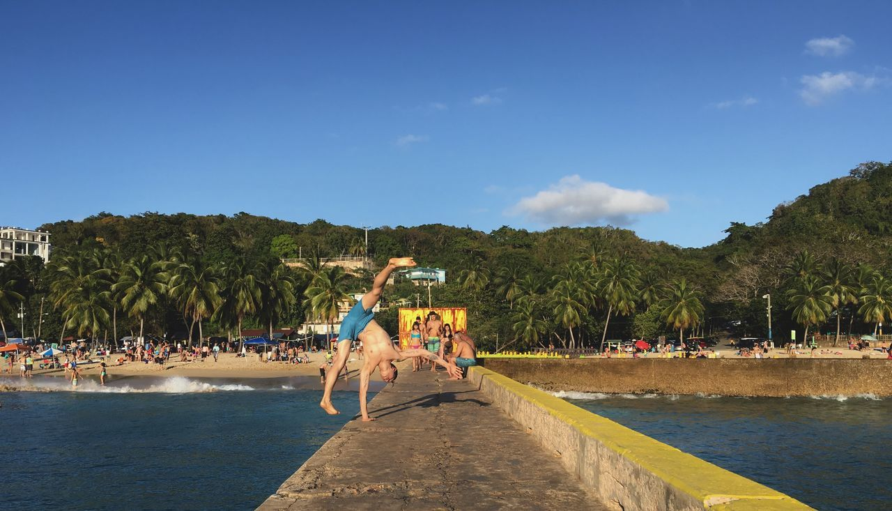 Balance. Photo by: Steph Del Rio, Aguadilla, Puerto Rico Balance Beach Crash Boat Beach Handstand  Ocean One Armed Hand Stand Outdoors Palm Tree Photography Puerto Rico Relaxation Travel Destinations Tree Water