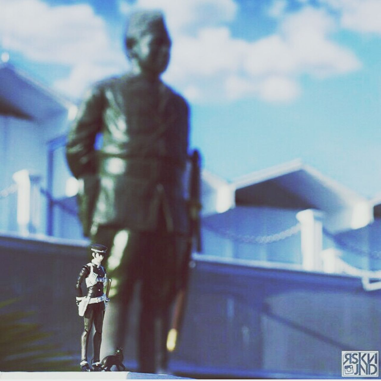 Sky Outdoors Toy People Monument