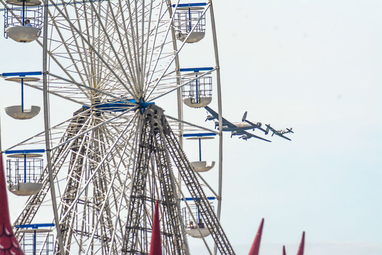 2017 Airshow with The Lancaster Bomber doing a fly-by of the Big Wheel Airshow Blackpool Seafront Airshowphotography Amusement Park Amusement Park Ride Arts Culture And Entertainment Big Wheel Clear Sky Day Ferris Wheel Lancaster Bomber Low Angle View No People Outdoors Sky South Pier
