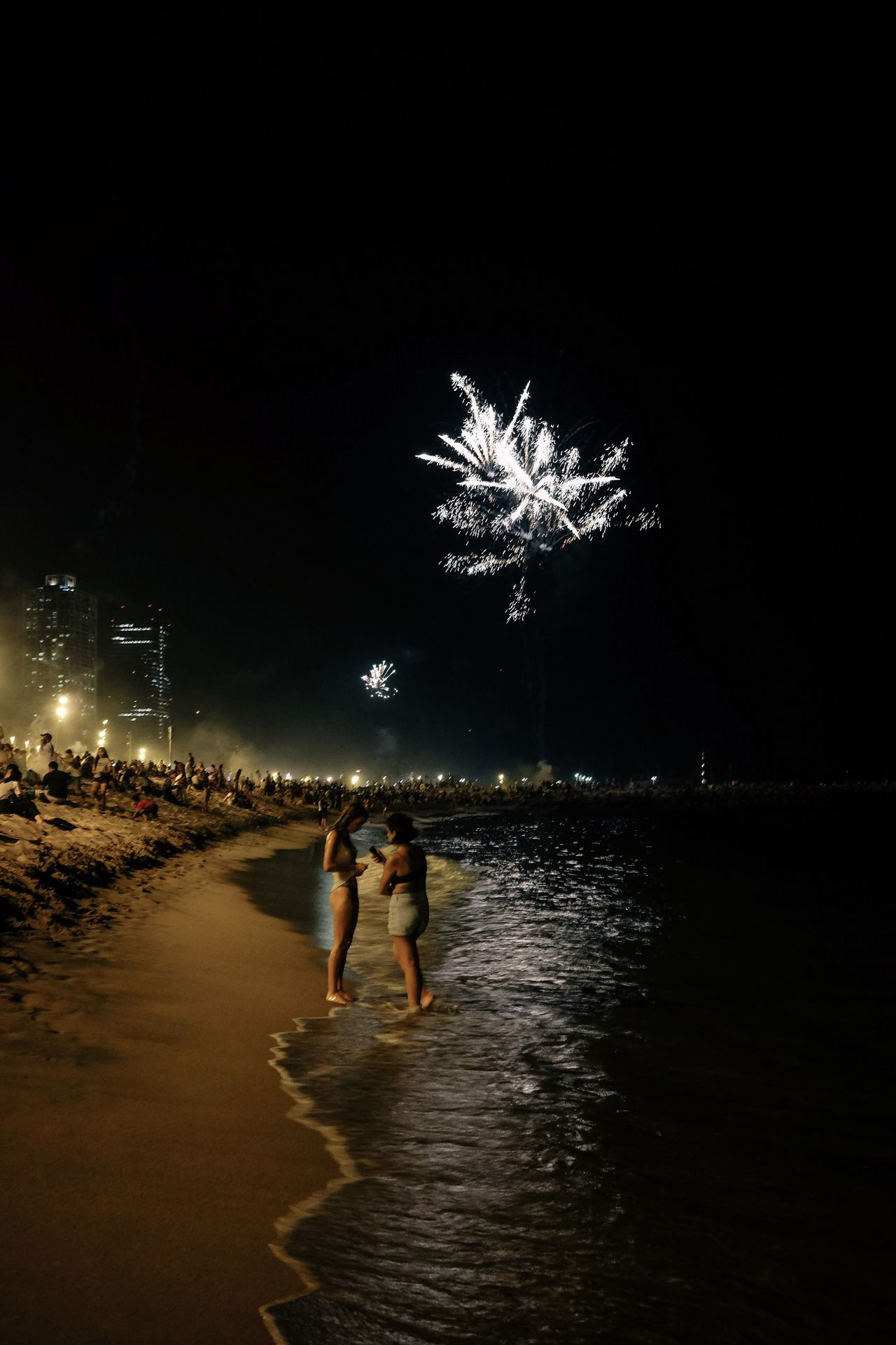 Night Illuminated Celebration Firework Display Firework - Man Made Object Vacations Full Length Real People Motion Outdoors Beach Firework Leisure Activity Men Arts Culture And Entertainment Lifestyles Water Women Tree Building Exterior Girls Beachphotography Beach