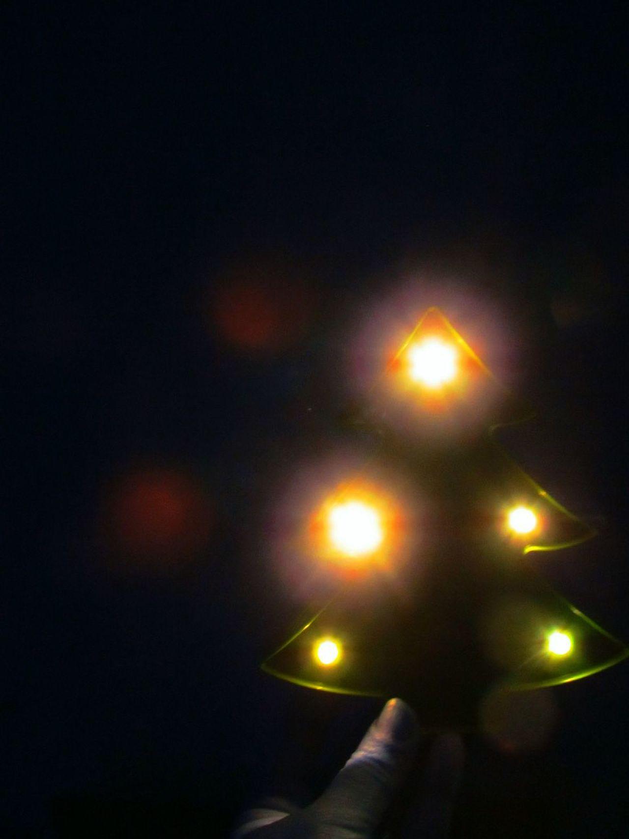 Night Illuminated Human Hand Black Background Close-up Christmas Tree Shape Bokeh Effect Bokeh Balls Bokeh Lights Light In The Darkness Light Effect Light And Darkness, Forms And Shapes Light And Darkness