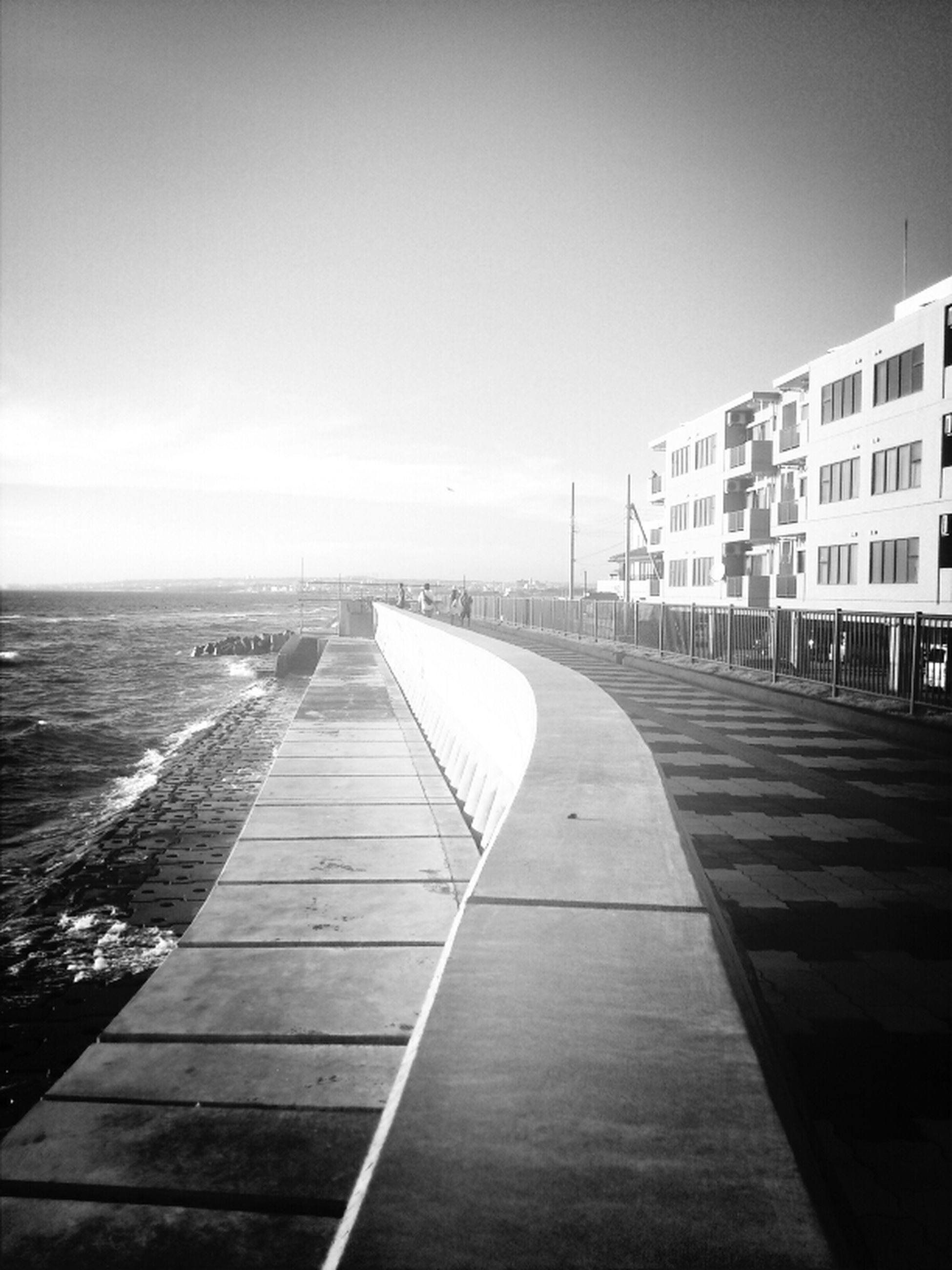 the way forward, sea, built structure, architecture, diminishing perspective, water, sky, building exterior, vanishing point, horizon over water, clear sky, long, railing, walkway, copy space, empty, day, pier, outdoors, incidental people