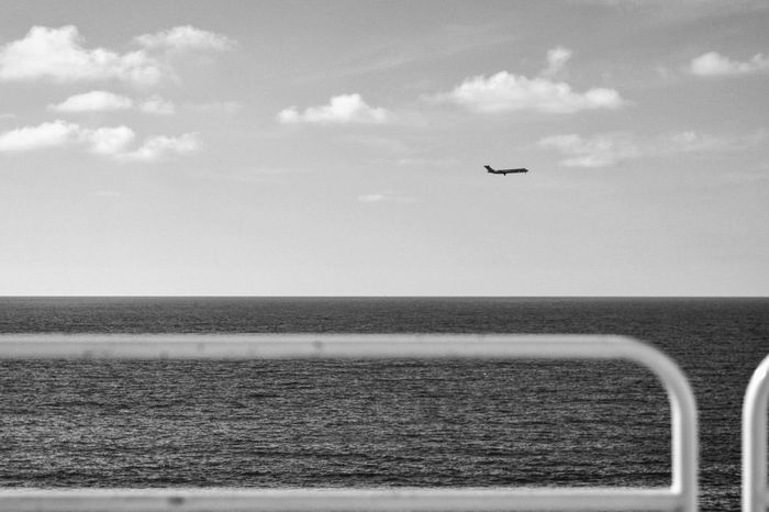 Flying Sky Mid-air Cloud - Sky Sea Outdoors Day No People Landscape Water Beach Airplane Nature Horizon Over Water Sicily Nature Nikon 50mm 1.8 Igerssicilia Palermo Cloud And Sky Black And White Photography Blacknwhite