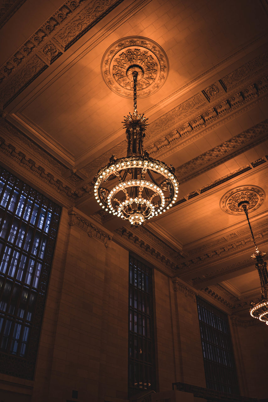 low angle view, ceiling, architecture, lighting equipment, hanging, built structure, indoors, illuminated, no people, day