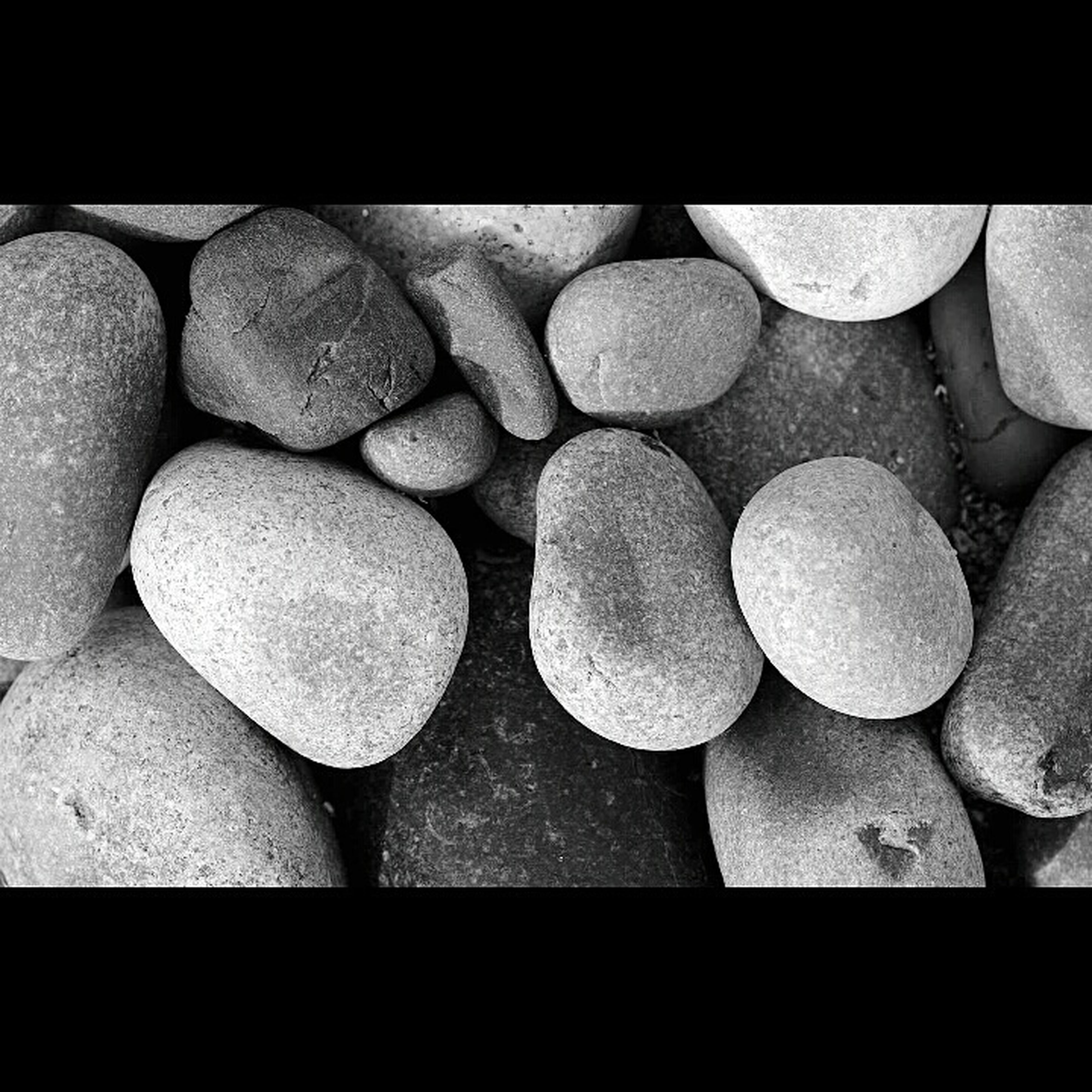 large group of objects, abundance, stack, arrangement, high angle view, still life, full frame, backgrounds, close-up, transfer print, order, in a row, auto post production filter, textured, pebble, shape, no people, stone - object, repetition, pattern