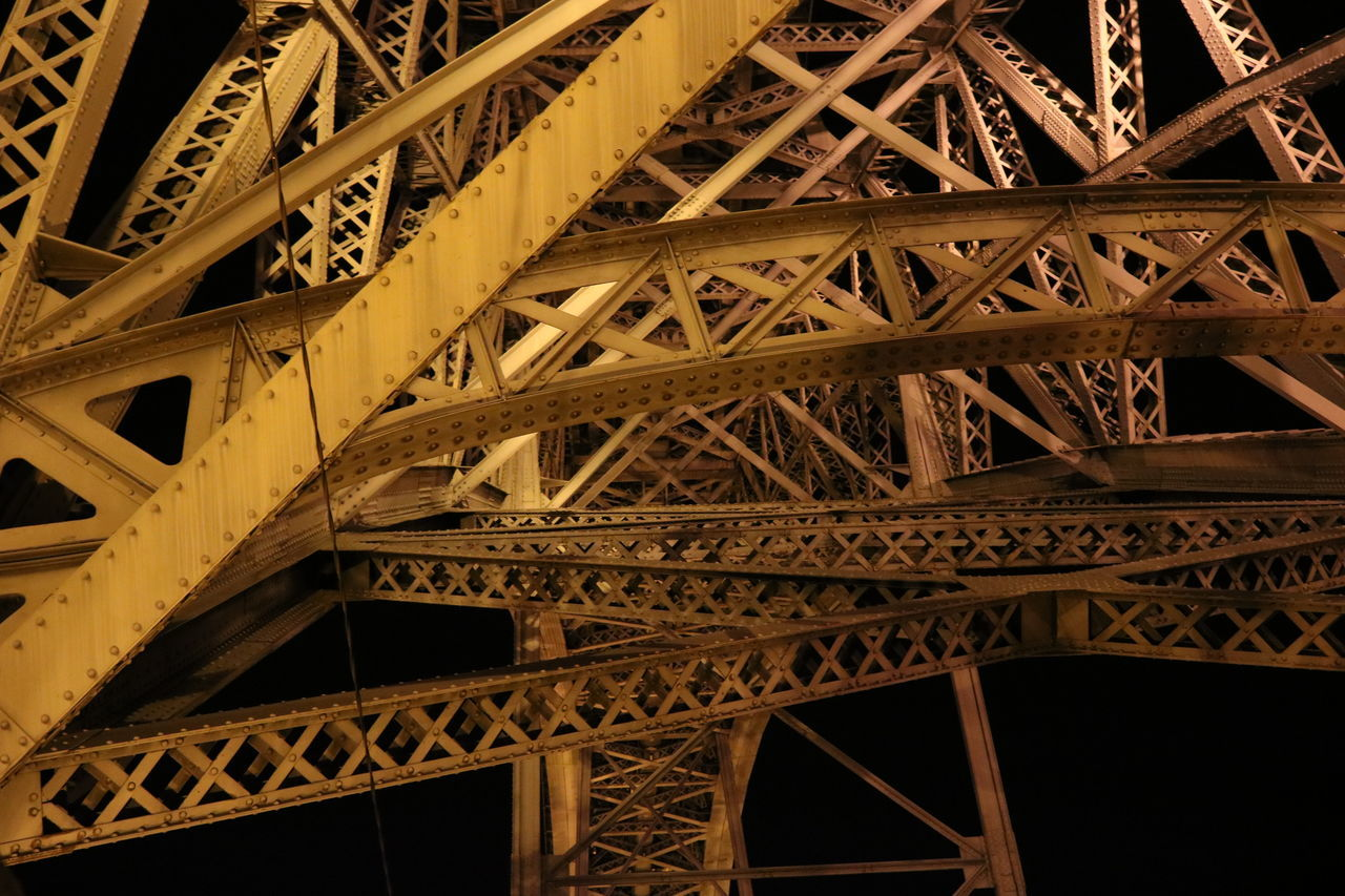 engineering, architecture, connection, built structure, architectural feature, metal, bridge - man made structure, travel, low angle view, travel destinations, girder, no people, complexity, illuminated, night, outdoors