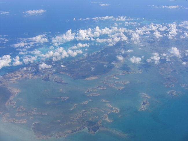 Above Aerial View Beauty In Nature Blue Cloud Cloud - Sky Cloudscape Coastline Day Idyllic Island Landscape Majestic Mountain Nature Non-urban Scene Ocean Remote Scenics Sea Seascape Tranquil Scene Tranquility View Into Land Water