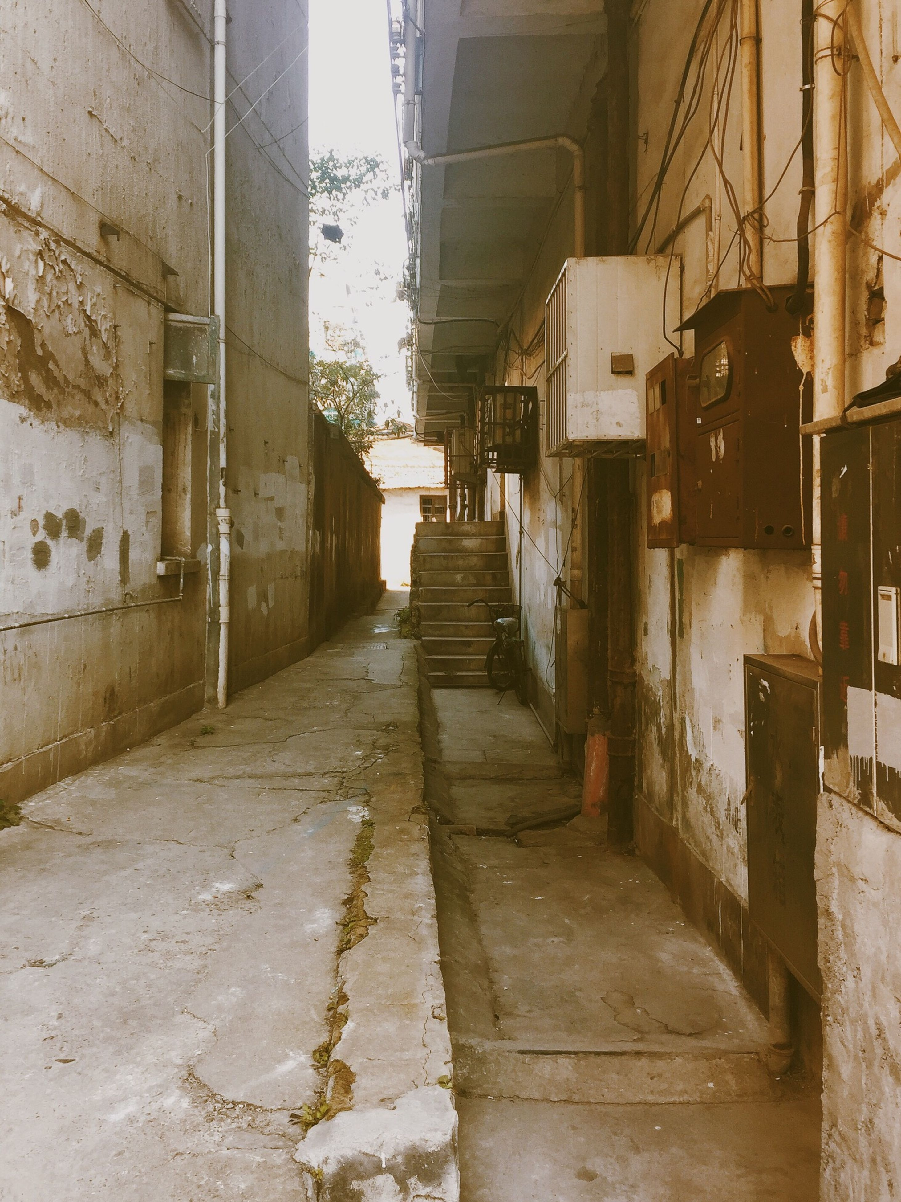 architecture, the way forward, built structure, diminishing perspective, indoors, narrow, vanishing point, corridor, building, wall - building feature, empty, old, building exterior, abandoned, alley, long, wall, no people, walkway, day