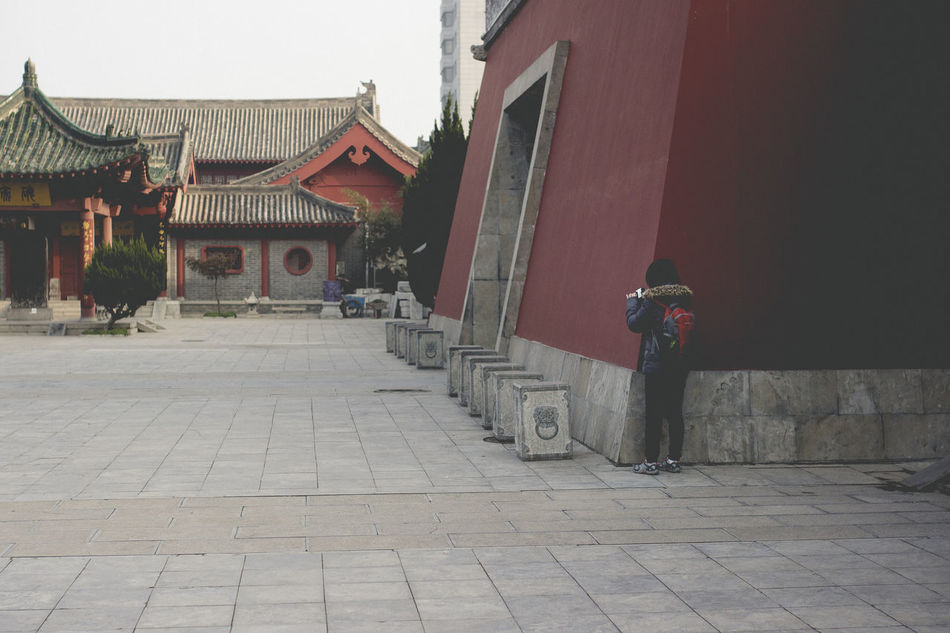 Architecture Backpack Brick Ground Building Exterior Built Structure Day Great Wall Lifestyles Men One Person Outdoors Real People Red Wall Taking Photos Taking Video Temple Tourist