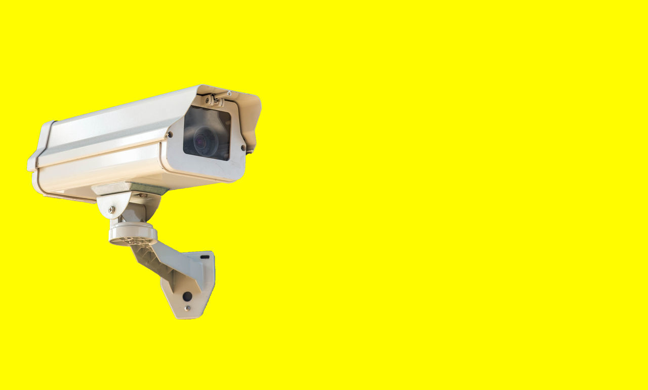 yellow, camera - photographic equipment, security camera, surveillance, safety, security system, technology, security, protection, photography themes, yellow background, no people, movie camera, spy, close-up, filming, television camera, day, outdoors