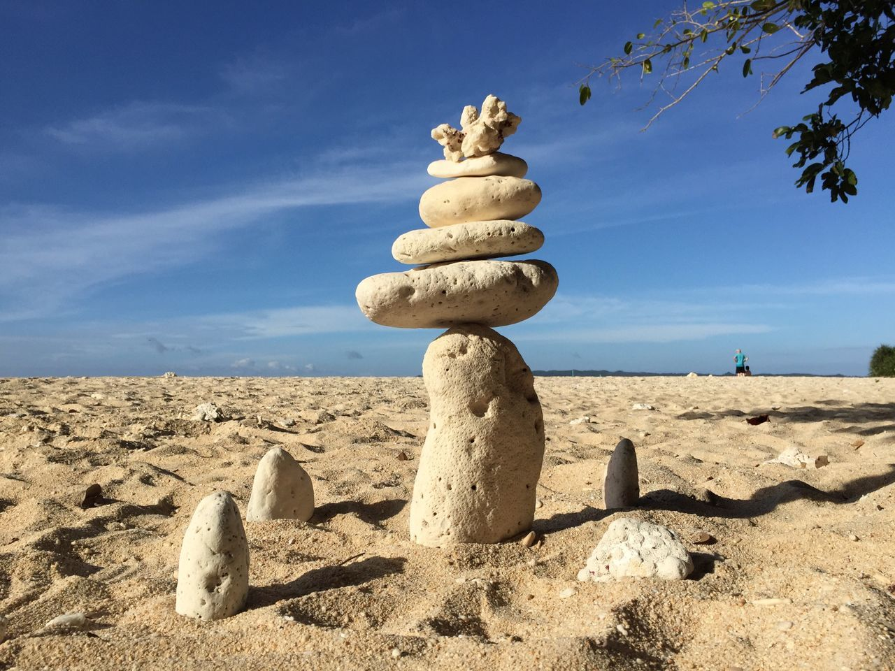 Sand Beach Sunlight Sky Shore Cloud - Sky Tranquility Blue Sandy In A Row Tranquil Scene Non-urban Scene Tourism Summer Zoology Nature Sunny Pebble Day Outdoors Coral Sculpture Sculptures By The Sea