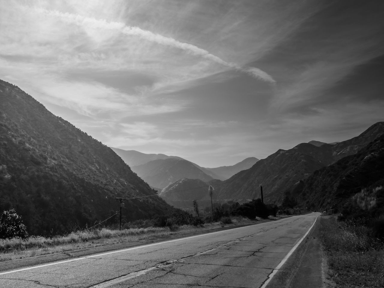 Black and White view down Big Tajunga Canyon Road Angeles National Forest Beauty In Nature Big Tujunga Canyon Day Landscape Mountain Mountain Range Nature No People Outdoors Road Scenics Sky The Way Forward Tranquil Scene Tranquility Transportation White Line Winding Road