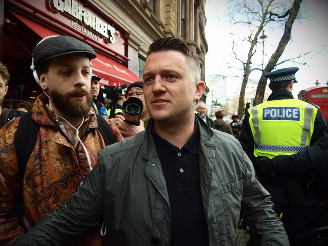 Tommy Robinson. Founder of the English Defence League, goading anti Facism protesters and being escorted away by Metropolitan police officers. London. 01-04-2017 Right Wing Racism Racist Policing Police Zuiko London News Steve Merrick Stevesevilempire London Uk English Defence League Metropolitan Police EDL Olympus Tommy Robinson