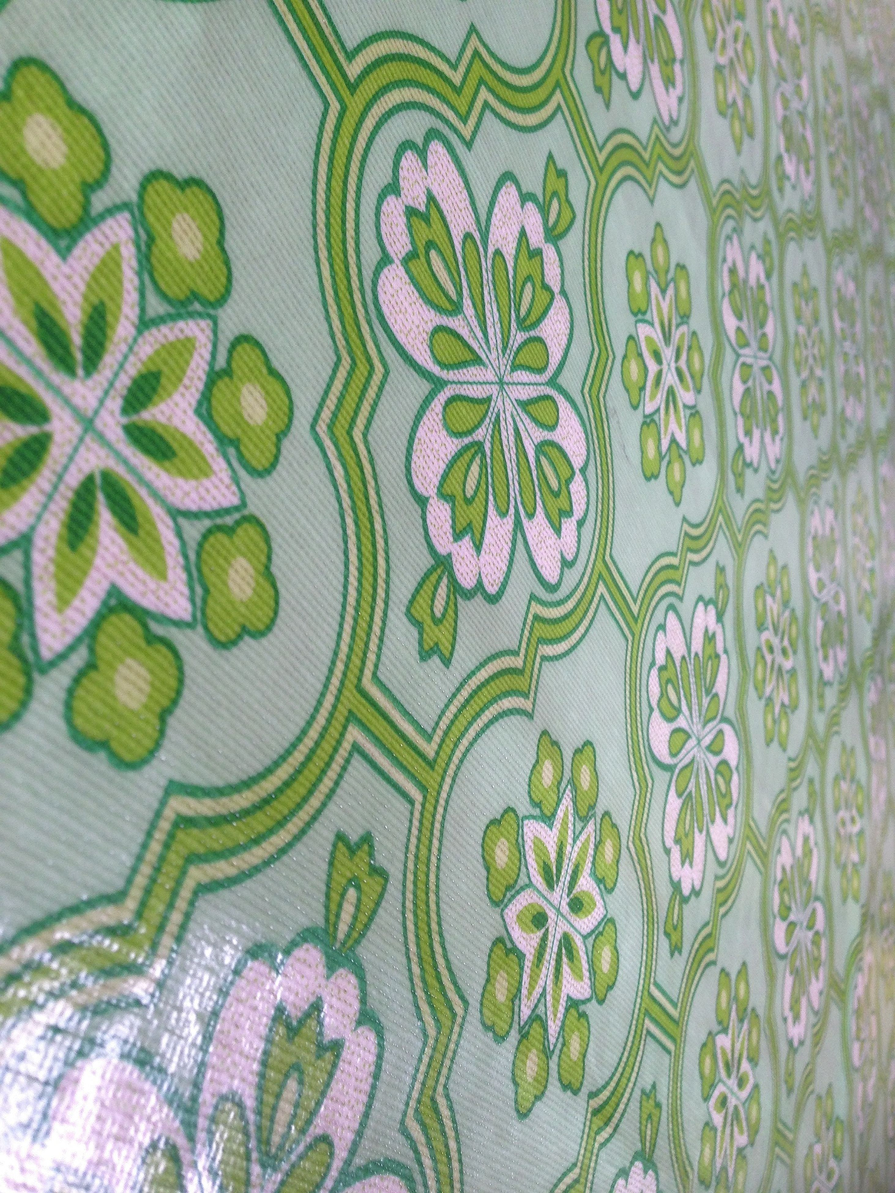 indoors, pattern, design, full frame, floral pattern, green color, backgrounds, wall - building feature, art and craft, creativity, art, close-up, leaf, high angle view, no people, textured, multi colored, textile, plant, decoration