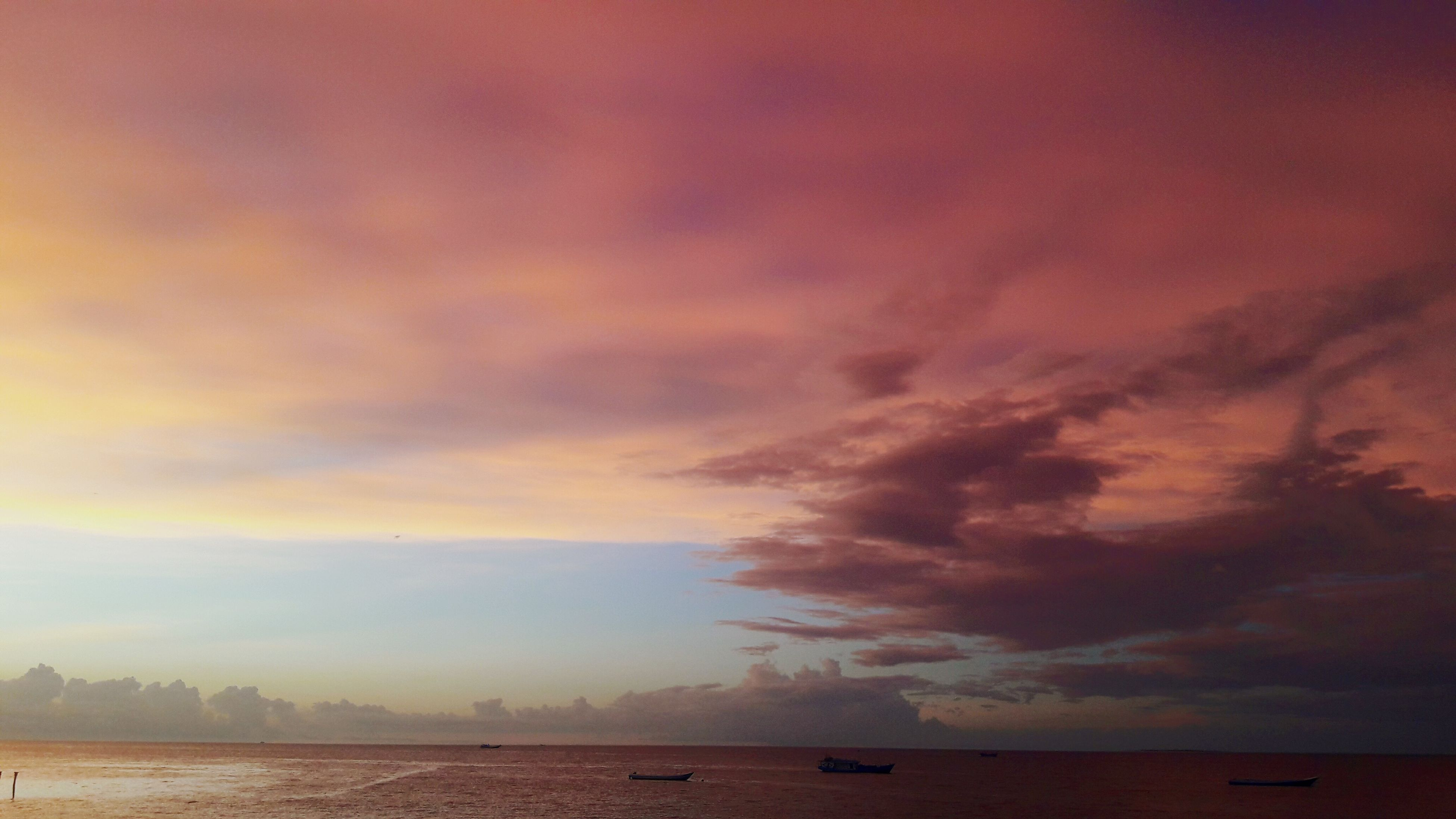 sea, water, sunset, beauty in nature, tranquility, cloud - sky, scenics, tranquil scene, nature, sky, outdoors, no people, horizon over water, beach, day