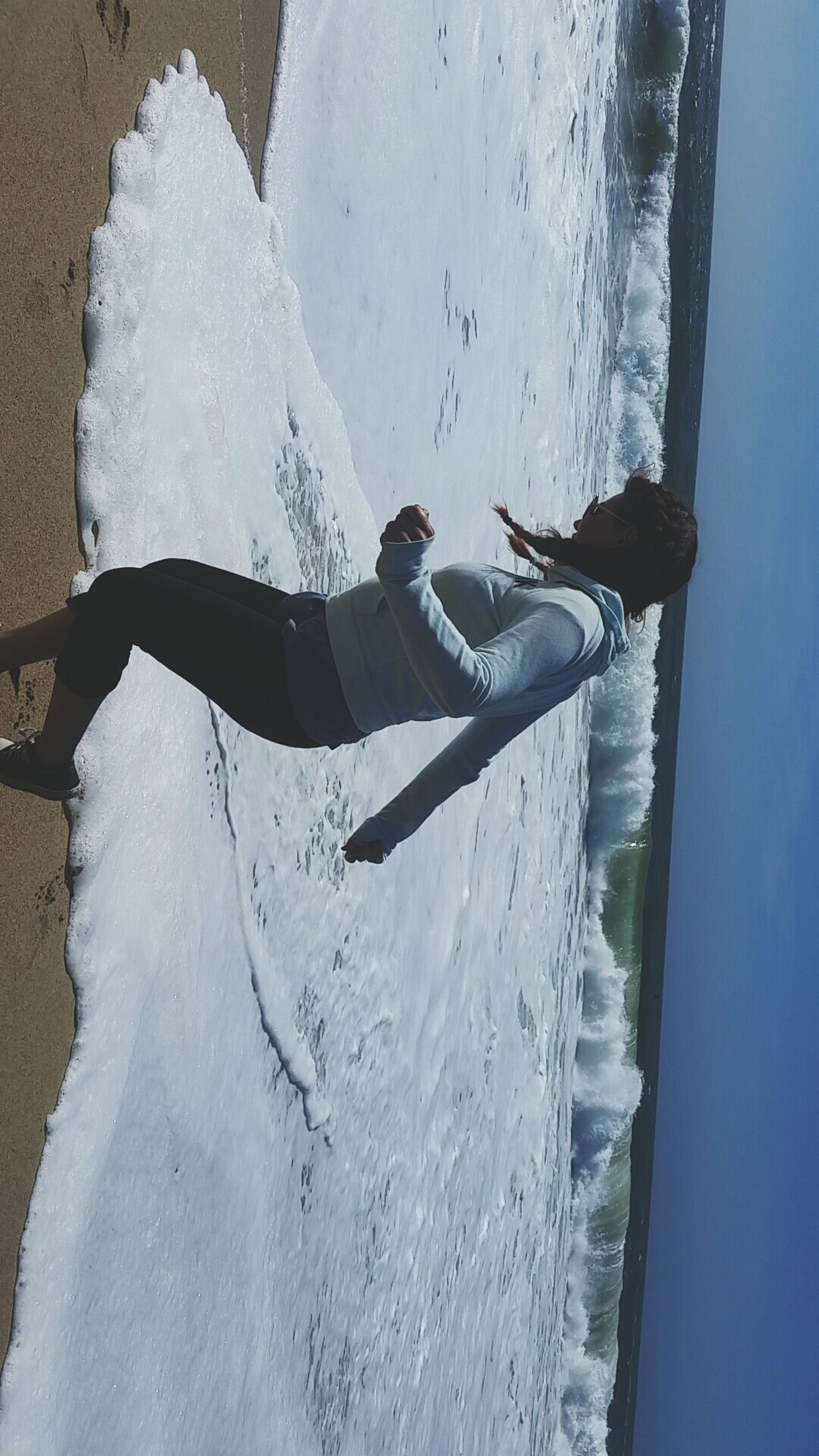 leisure activity, lifestyles, winter, water, cold temperature, snow, full length, season, motion, men, vacations, enjoyment, surf, person, high angle view, day, fun