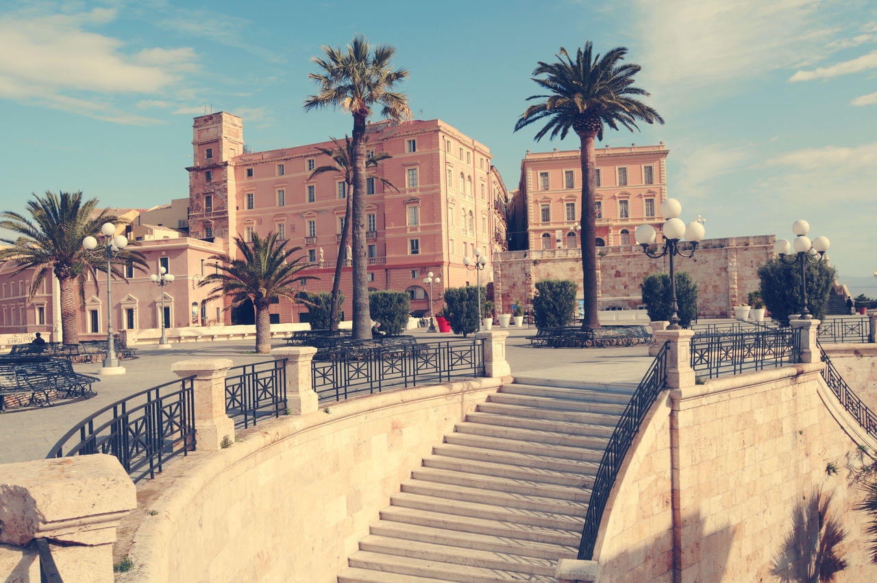 View of the ramparts of Cagliari Architecture Building Building Exterior Built Structure City City Life Cloud Cloud - Sky Day Façade Footpath No People Outdoors Palm Tree Ramparts Sky Sunlight Sunny The Way Forward Tourism Travel Destinations Tree Walkway
