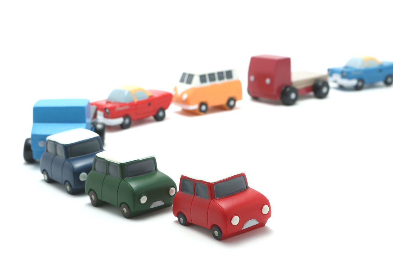 Automobile Car Concepts Congestion Croweded Curve Drive Drivers Driving Highway Many Miniature Model Motorcade Motorcar Road Roadtrip Rush Studio Shot Toycars Traffic Traffic Jam Transportation Vehicle White Background