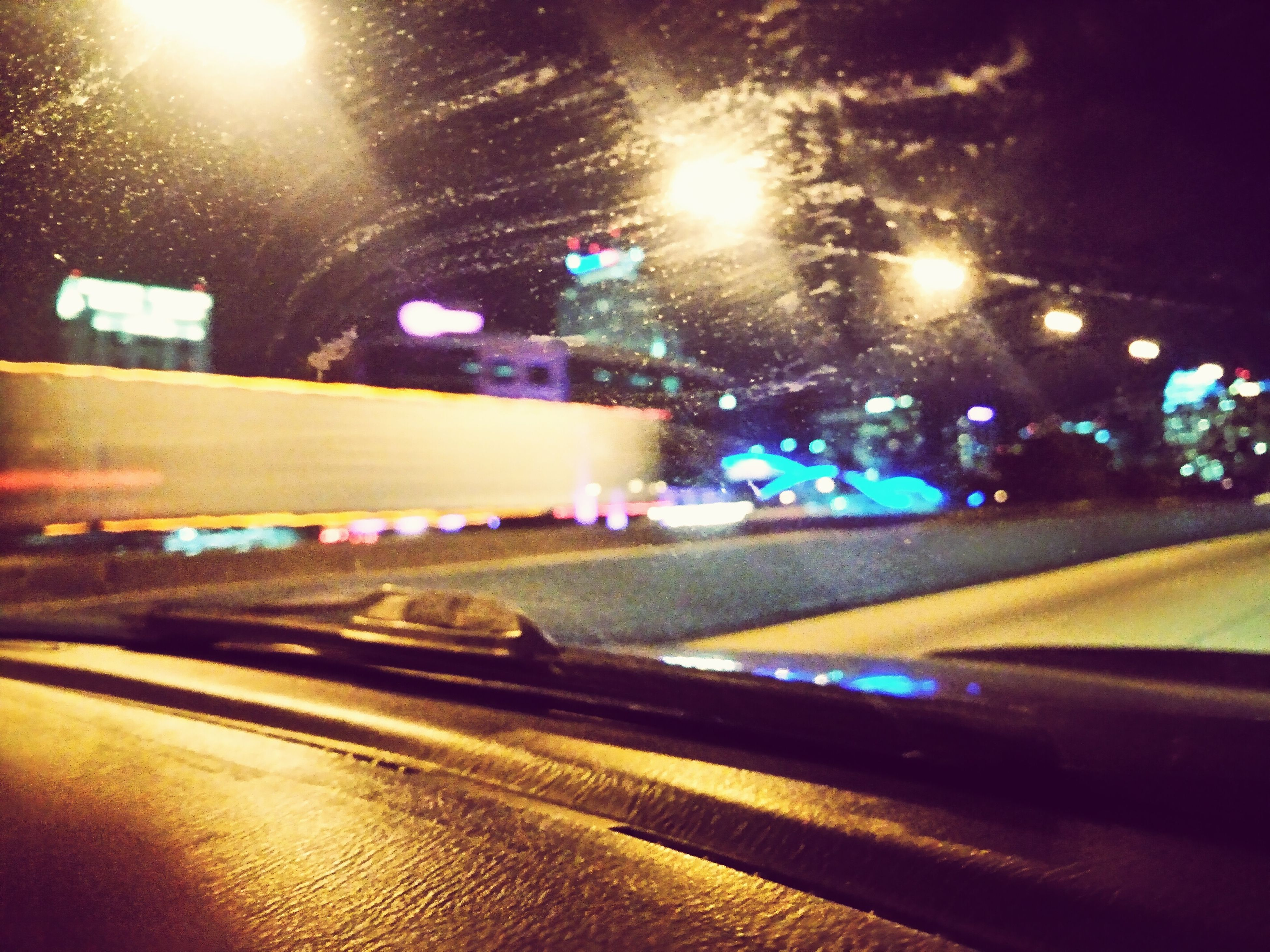 illuminated, night, transportation, city, car, land vehicle, lighting equipment, street light, road, street, mode of transport, traffic, light - natural phenomenon, city street, light trail, city life, building exterior, motion, long exposure, architecture