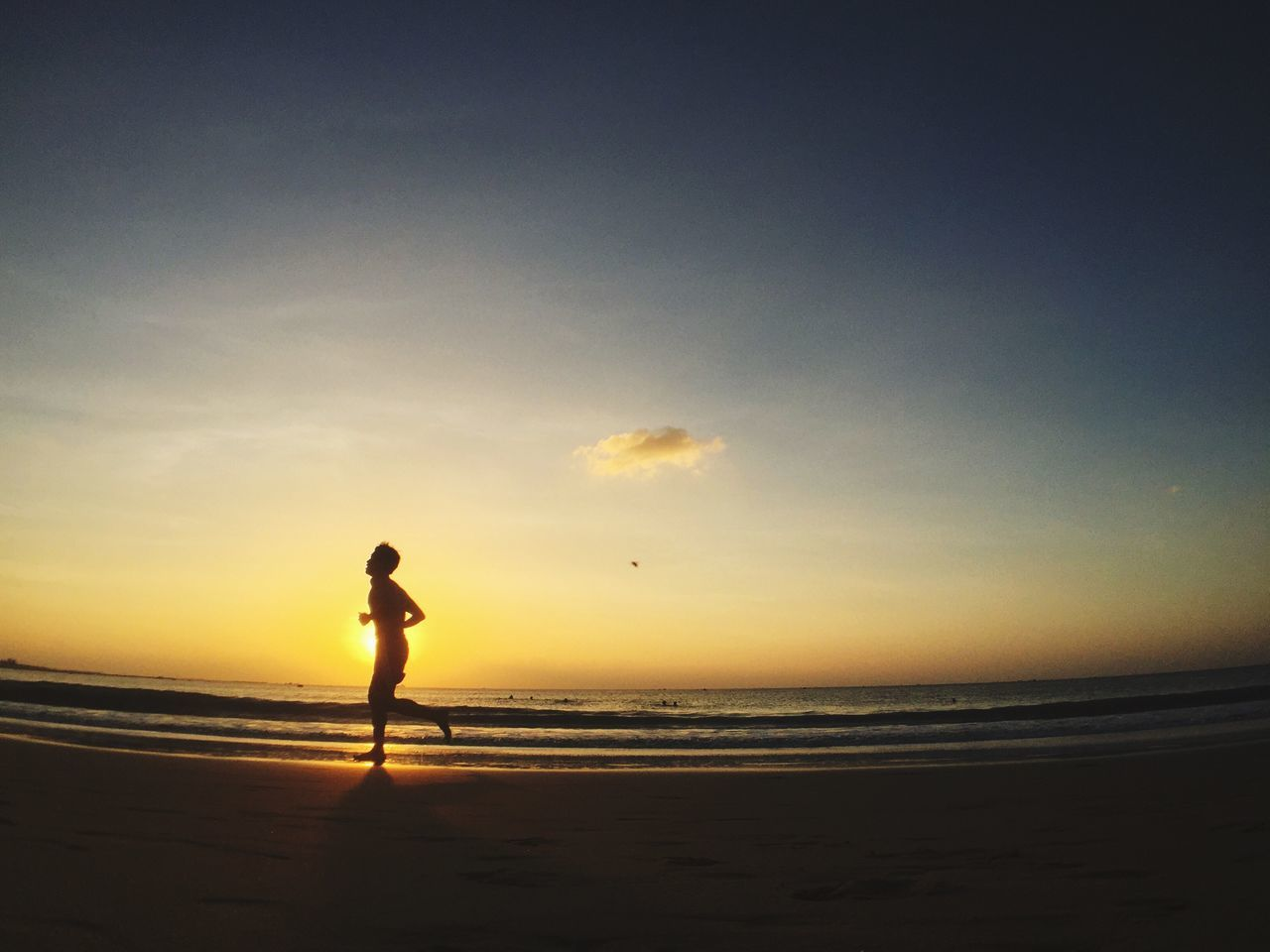 Man Running On Sea Shore During Sunset