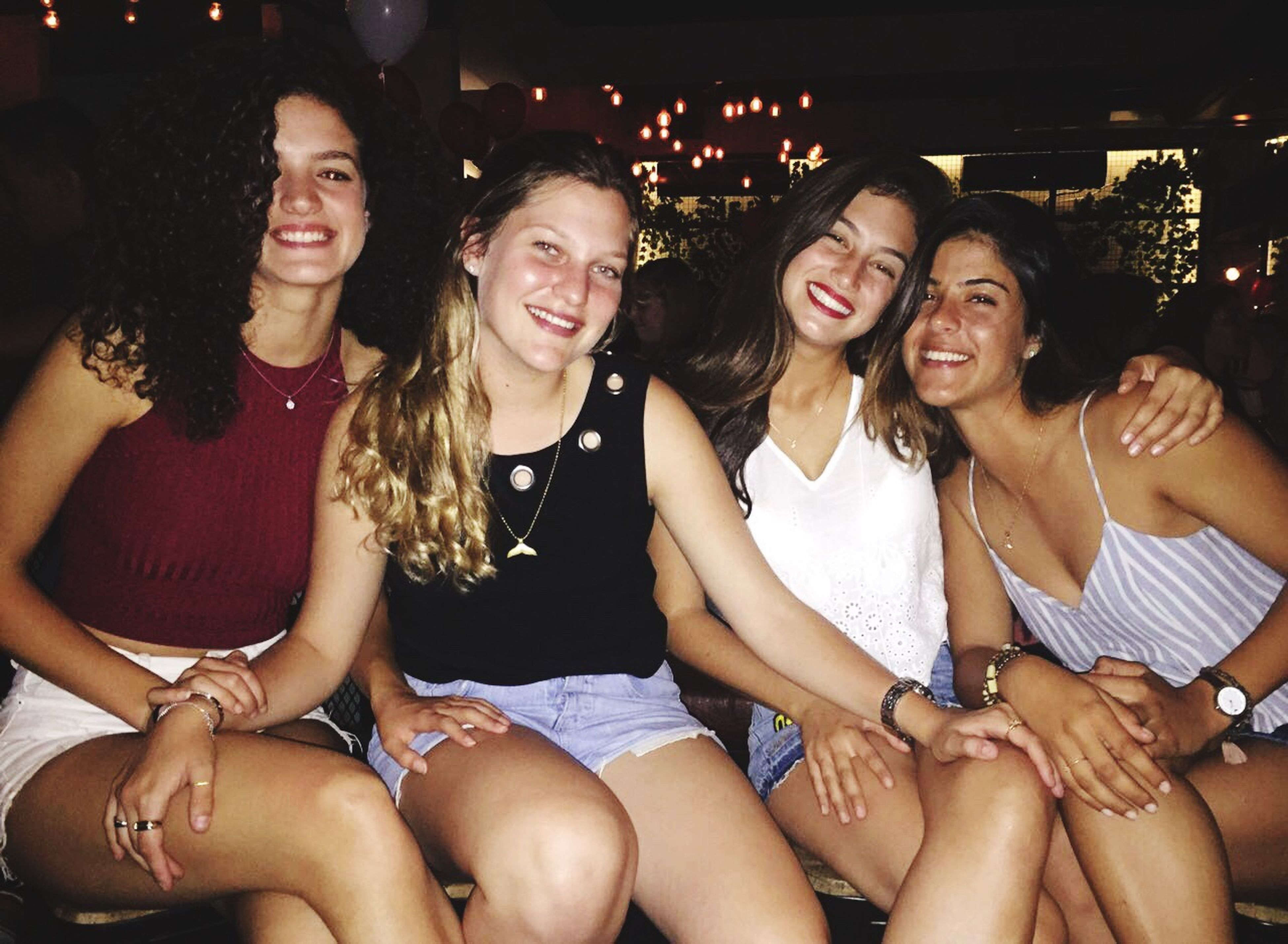 young women, leisure activity, young adult, friendship, smiling, lifestyles, togetherness, happiness, indoors, toothy smile, long hair, casual clothing, front view, person, looking at camera, enjoyment, beauty, friend, female, friends