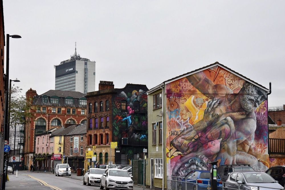 Street art Manchester England. Architecture Building Exterior Built Structure Human Representation City Multi Colored Sky Outdoors Real People Day Getty X EyeEm Northern Quarter Manchester EyeEm Gallery Street Art/Graffiti Architecture Street Photography Graffiti Eyeem Community Graffiti Art EyeEm Masterclass Graffiti & Streetart EyeEm Best Shots Streetart EyeEm