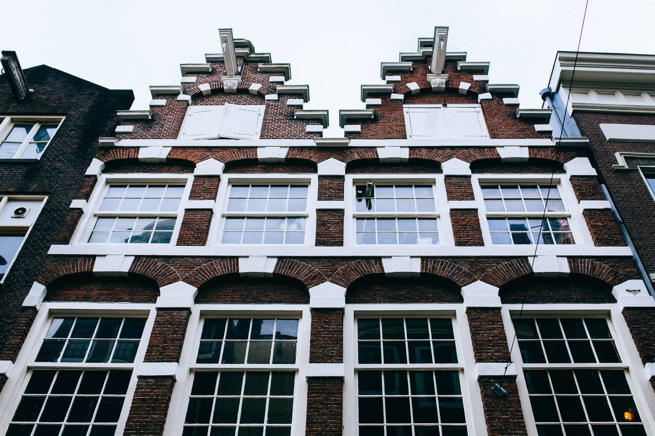 A Wintery Amsterdam... All Streets Amsterdam Apartment Architecture Building Building Exterior Built Structure City Clear Sky Day Façade Full Frame Glass - Material In A Row Low Angle View No People Outdoors Repetition Residential Building Residential Structure Sky Window Your Amsterdam EyeEm X Google - Your Amsterdam