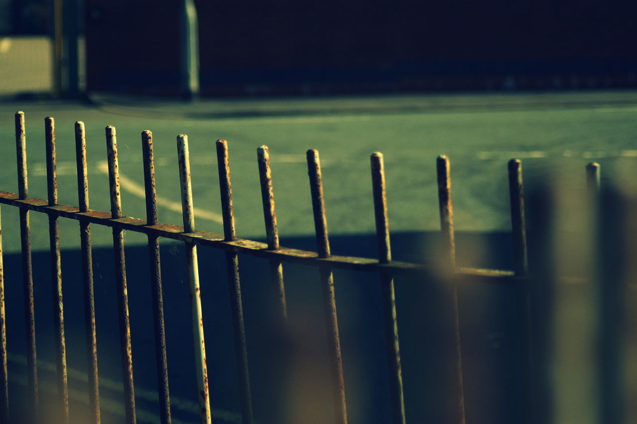 selective focus, no people, close-up, metal, green color, day, outdoors, security bar