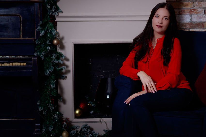 EyeEmSelect Beautiful Woman Christmas Front View Full Length Home Interior Indoors  Lifestyles Long Hair One Person One Young Woman Only Sitting Young Adult Young Women