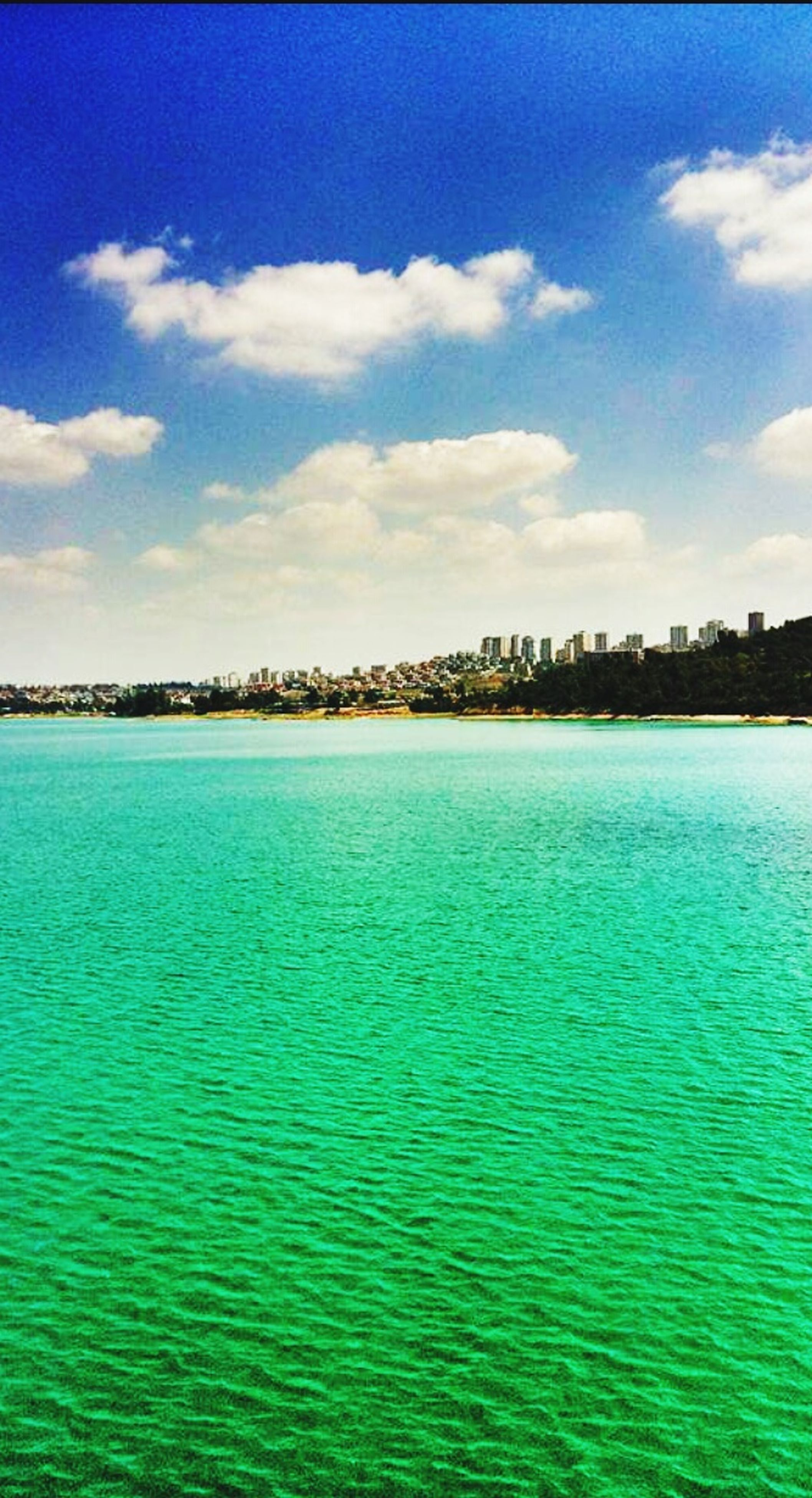 water, blue, waterfront, sky, tranquil scene, tranquility, scenics, rippled, beauty in nature, nature, cloud, idyllic, cloud - sky, turquoise colored, day, outdoors, no people, calm, seascape, remote, non-urban scene, non urban scene, ocean, water surface