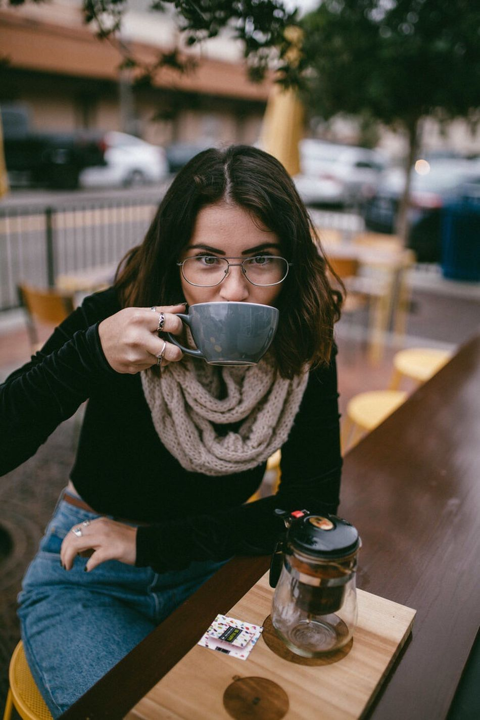 Real People Table Drink One Person Young Adult Young Women Drinking Front View Indoors  Food And Drink Focus On Foreground Lifestyles Sitting Portrait Eyeglasses  Day Women Adult People Adults Only Tea Lifestyle Cafe Coffee Latte
