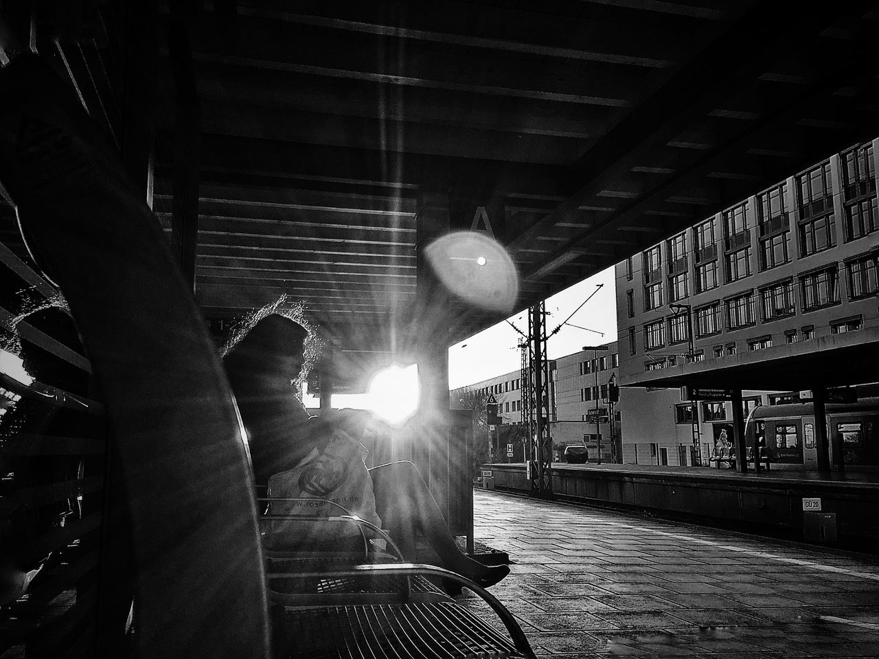 transportation, real people, lens flare, public transportation, rail transportation, built structure, architecture, building exterior, outdoors, men, day, one person, people