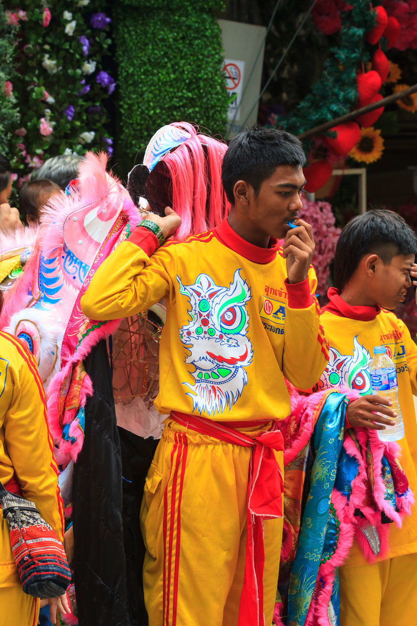 real people, traditional clothing, cultures, tradition, celebration, lifestyles, multi colored, traditional festival, outdoors, boys, day, women, leisure activity, traditional dancing, men, large group of people, togetherness