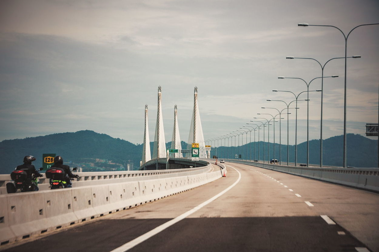 Day Outdoor Landscape Speed Highway Road Divider Penang Bridge ASIA Malaysia Pulau Pinang Bridge Mountain Lamp Light Pole Structure Clouds And Sky Metal Sky Cloud Motorcycles The Great Outdoors - 2016 EyeEm Awards The Architect - 2016 EyeEm Awards The Street Photographer - 2016 EyeEm Awards