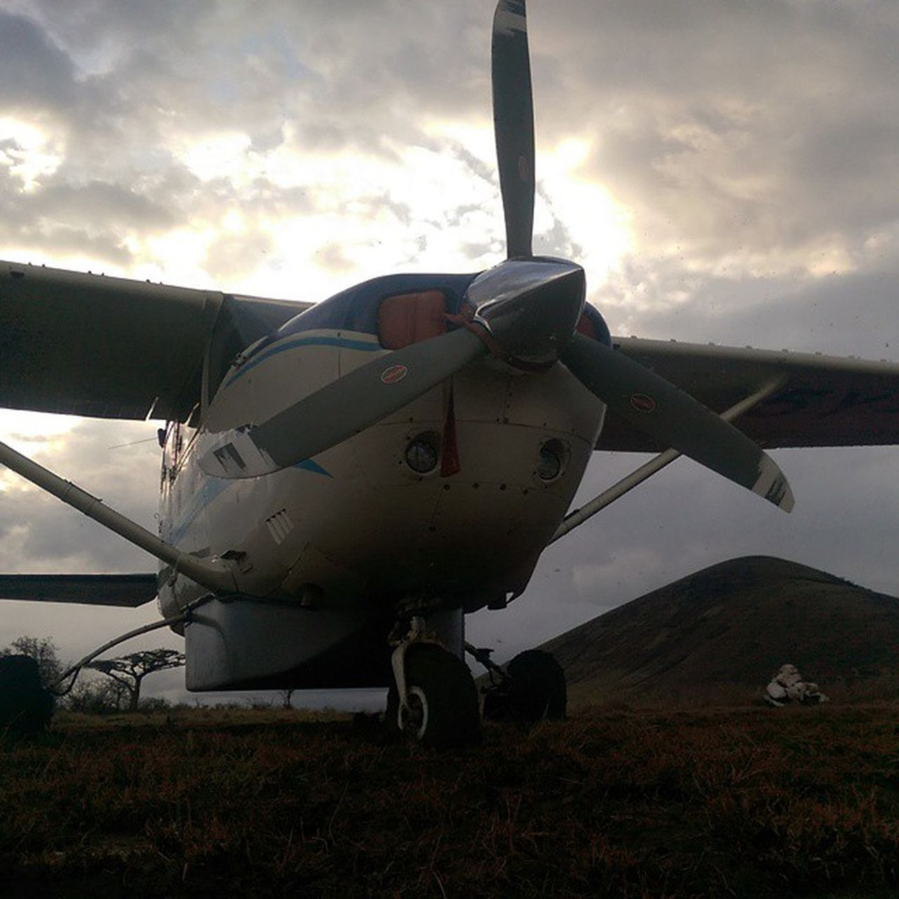 Flying in to remote desert strips in rainy season can be a risky business as we spent the night with the plane stuck in the mud in Karabara. I took this with my Htconem8 this morning just before we pushed and dug it out. Flyingadventure Kenya Africa photooftheday igkenya cesna
