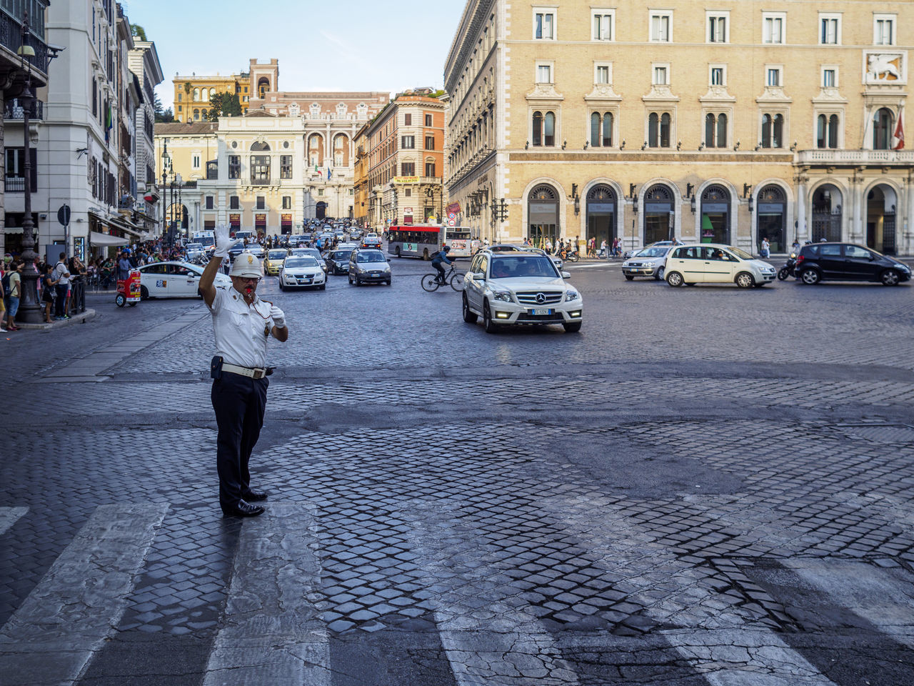 A traffic policeman directs the traffic in Rome Car City Life Italy Rome Street Street Photography Streetphotography Traffic Police  Zebra Crossing