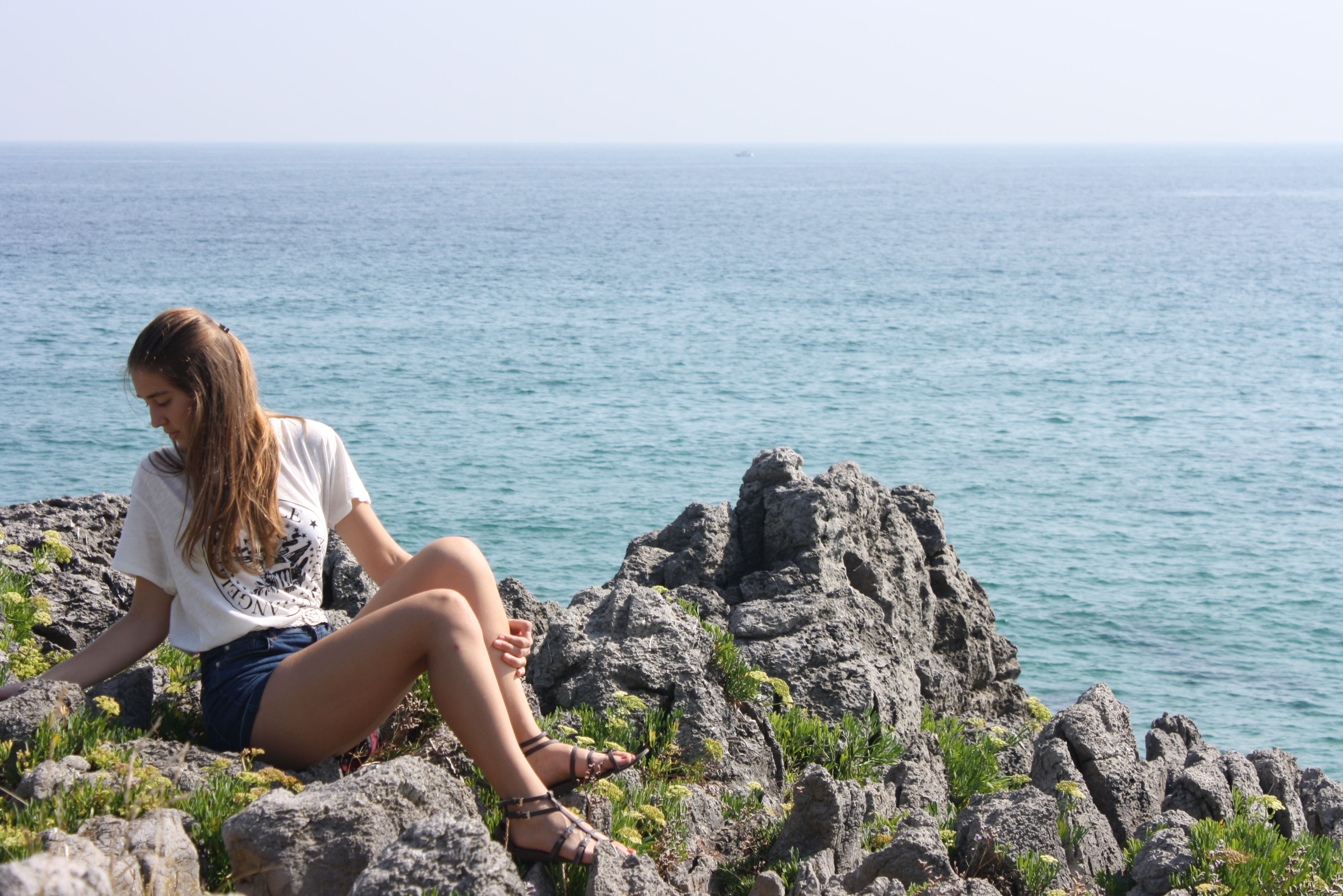 sea, horizon over water, lifestyles, leisure activity, water, person, beauty in nature, tranquil scene, scenics, tranquility, sitting, rear view, young women, young adult, nature, vacations, relaxation, rock - object
