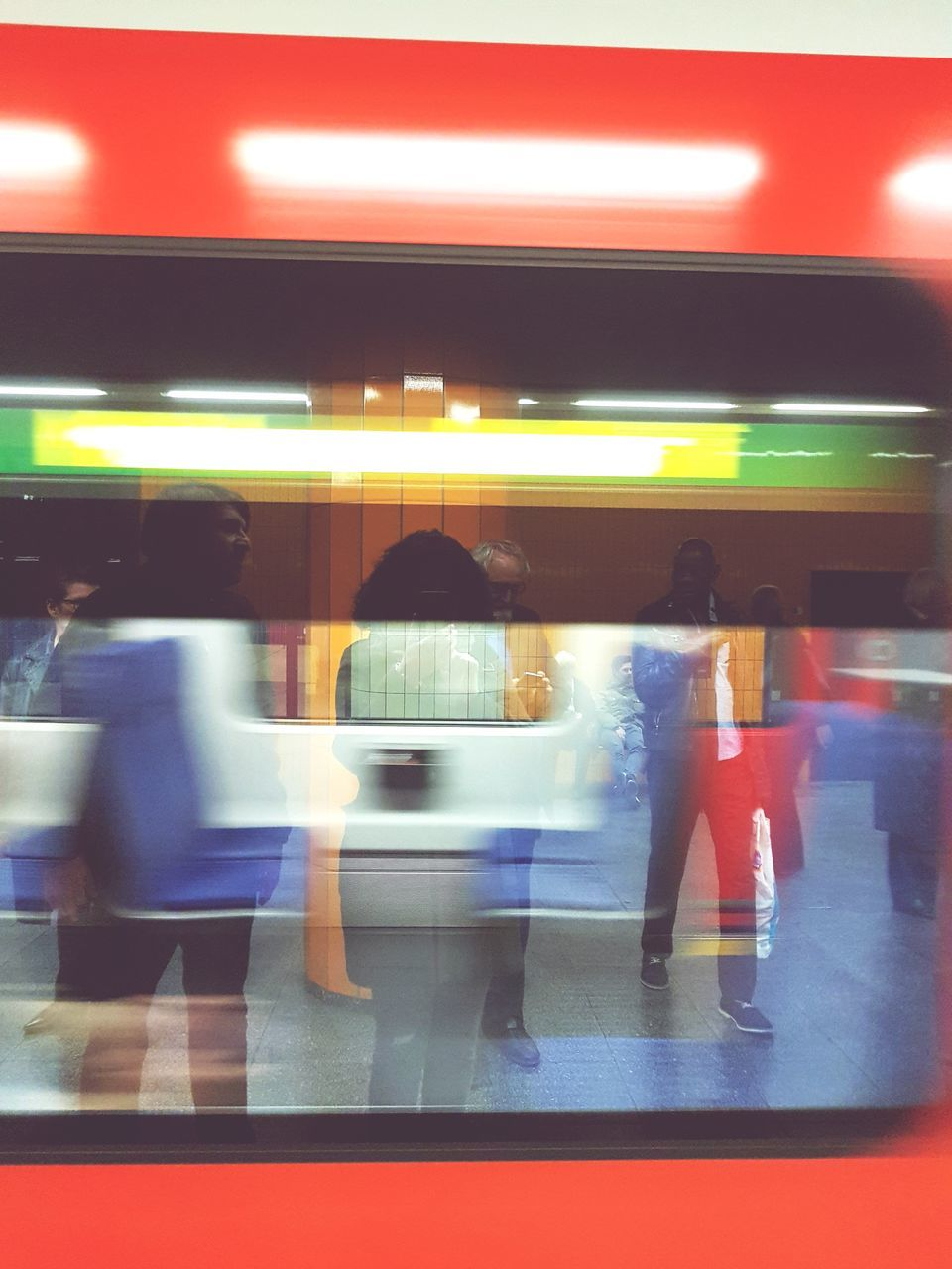 blurred motion, transportation, public transportation, motion, illuminated, train - vehicle, speed, real people, railroad station, indoors, passenger, rail transportation, mode of transport, travel, journey, subway train, women, commuter, walking, men, large group of people, waiting, long exposure, lifestyles, station, day, people