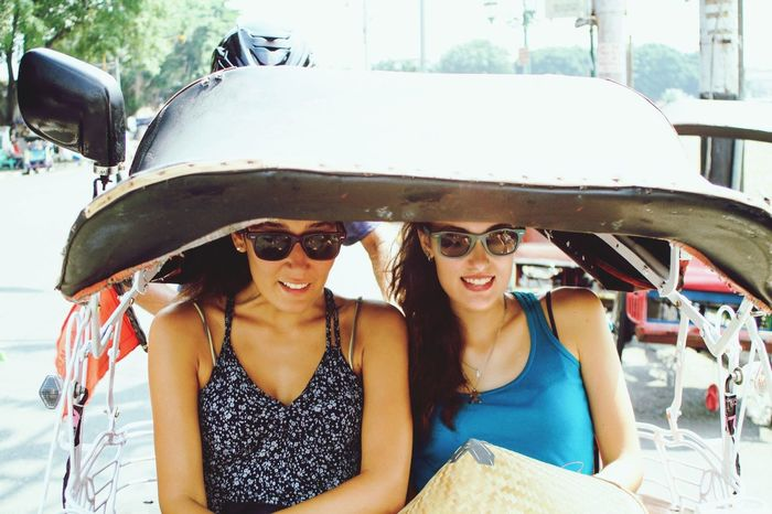 Transportation Car Smiling Sunglasses Young Women Mode Of Transport Young Adult Front View Fun Day Happiness Portrait Cheerful Land Vehicle Two People Enjoyment Leisure Activity Friendship Sitting Becak ASIA Let's Go. Together. Connected By Travel
