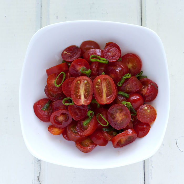 Fresh cherries tomatoes salad with green onion. Bowl Cherries Tomatoes Close-up Day Directly Above Food Food And Drink Freshness Green Onion Healthy Eating High Angle View Indoors  No People Ready To Eat Red Salad Square Dish Summer Table Tomato White White Background White Dish Wooden Background