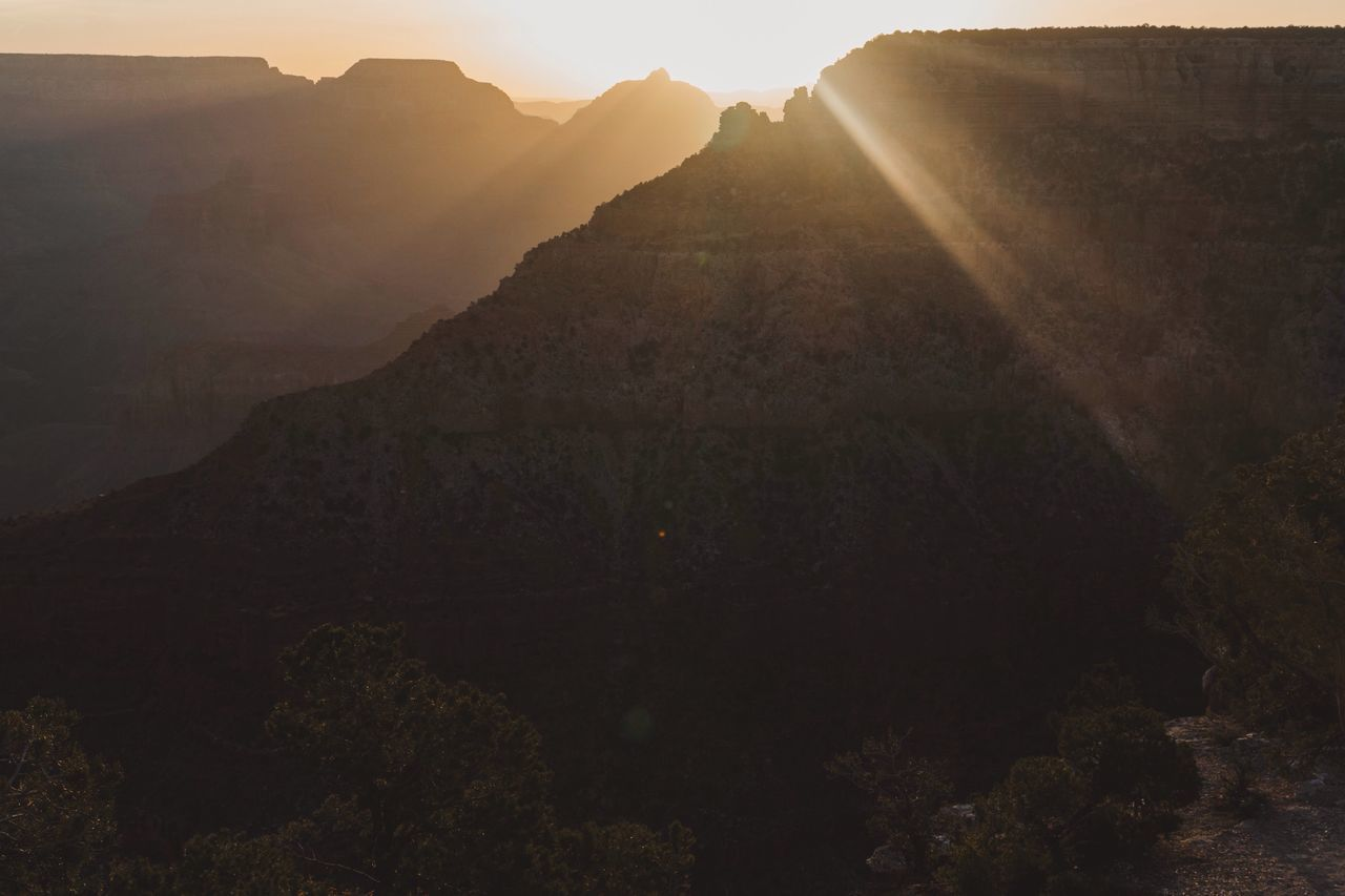 The glory of a sunrise at the Grand Canyon South Rim. POW! Mountain Nature Beauty In Nature Tranquility No People Scenics Mountain Range Physical Geography Outdoors Day Sky Sunrise Sunlight Sun Rays Silhouette Grand Canyon Orange Warmth Tranquility Peaceful Travel Destinations Tourism Destination