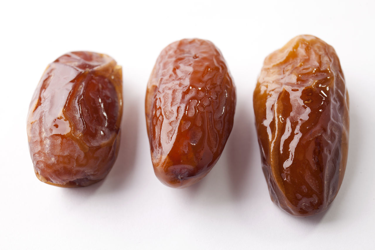 Date Fruit Close-up Color Image Date Date Fruit Dried Fruit Focus On Foreground Food Food And Drink Freshness Fruit Healthy Eating Indoors  Ingredient No People Photography Ready-to-eat Still Life Studio Shot White Background