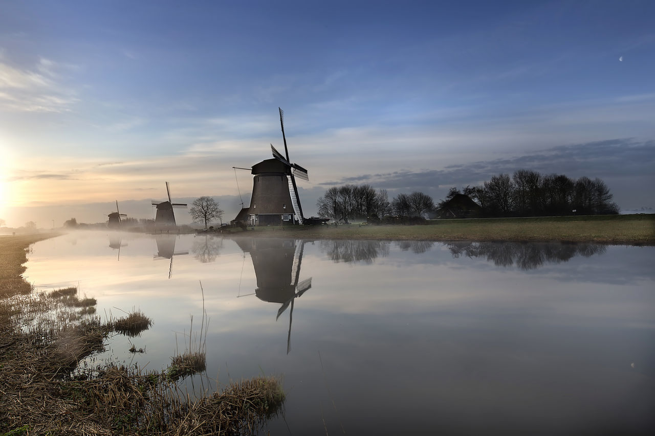 Beauty In Nature Channels Cloud - Sky Holland Landmark Museum Nature No People Outdoors Place Reflection River Rural Scene Sky And Clouds Sunrise Tourism Traditional Windmill Tranquility Travel Destinations Trees Water Wind Power