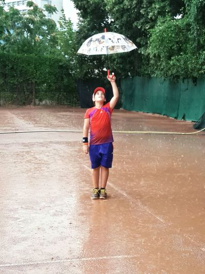 Rain Child One Person Wet Water Standing Real People People Outdoors Nature Day Full Length Tennis 🎾 Tenniscourt Tennis Player Tennis Shoes Tennislife Tennis Game Tennis Practice Tennis Club Tennislover❤ Tennis Practice :D Healthylife Sport Sport In The City
