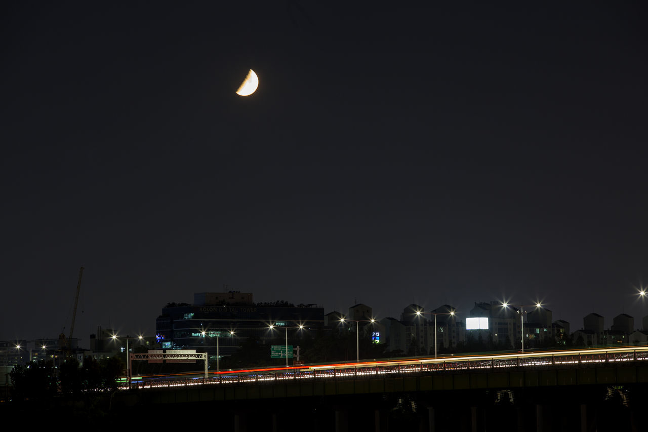 night, illuminated, moon, outdoors, transportation, sky, street light, no people, clear sky, architecture, city, building exterior, nature