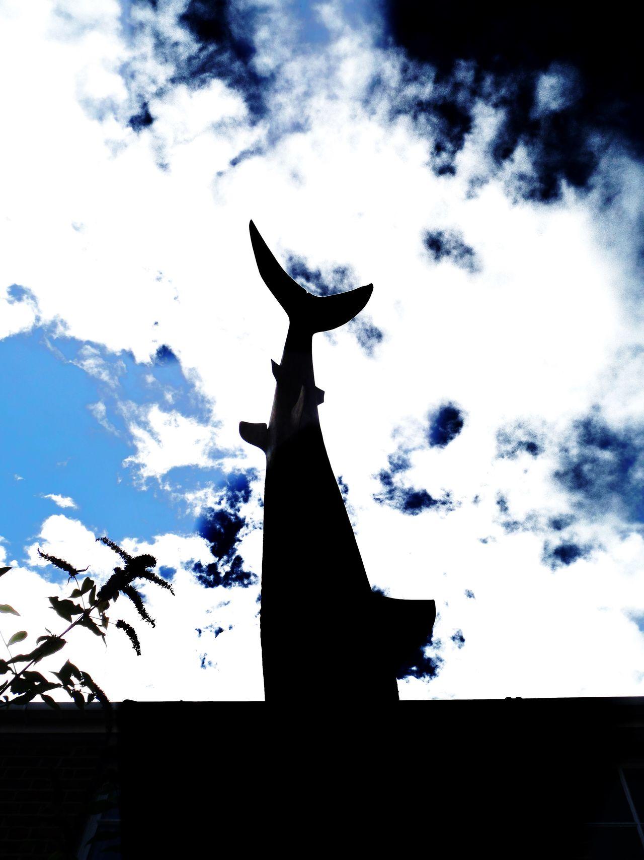 Architecture Black. Blue Cloud - Sky Day Ediyt Landmark. No People No People. Beauty In Nature Diamond Pattern Outdoors Sculpture Shark Sculpture In Rooftop. Silhouette.. Sky Statue Sunlight Tree