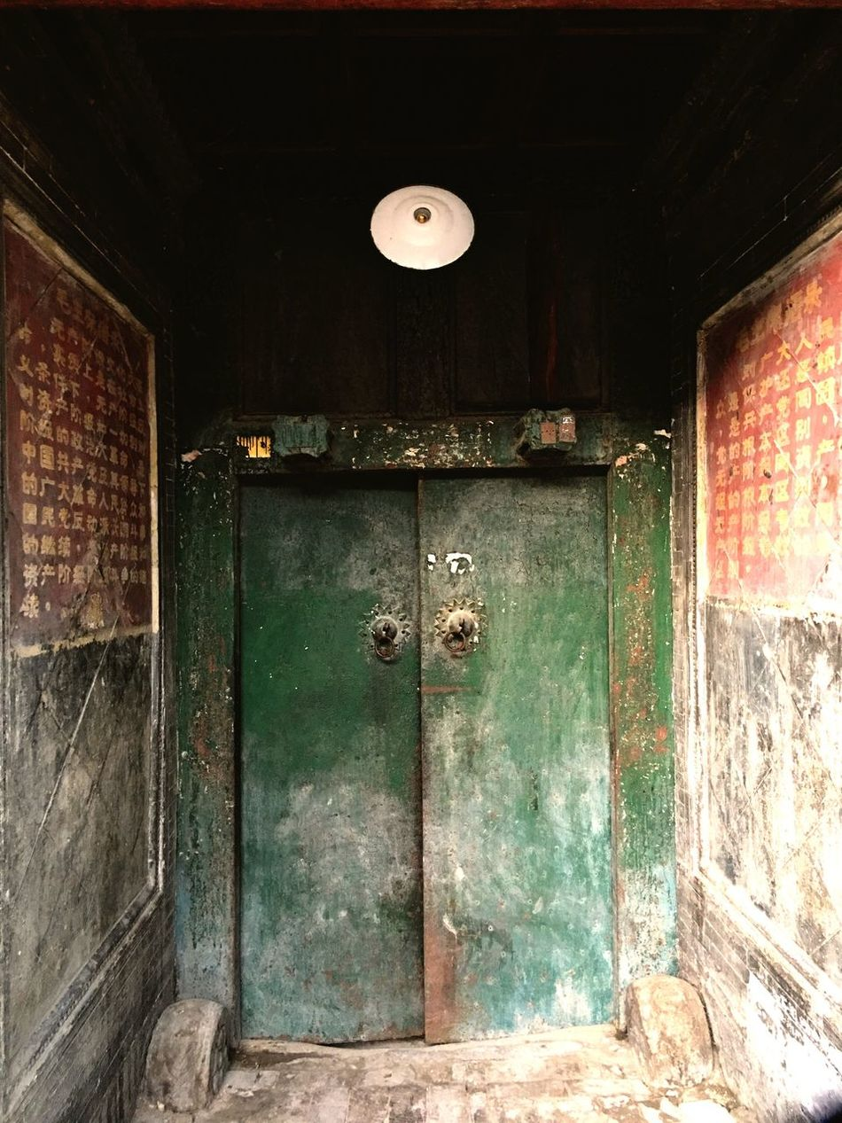 Beside the door there are two sentences of special period in our country. It's unusual to saw nowadays. Door Green Doors Closed Old Entrance Architecture History Wooden Brick Wall Iphonephotography The Secret Spaces