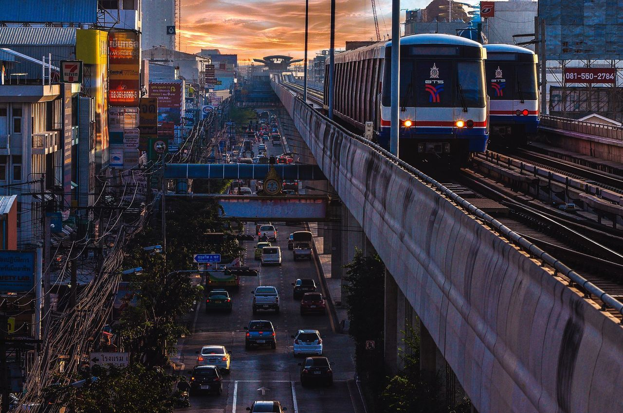 Bearing BTS. Transportation Dusk City Illuminated Sky Train - Vehicle Night Traffic Travel Destinations Mode Of Transport Architecture Outdoors Car Cityscape Built Structure Bridge - Man Made Structure Cloud - Sky Road No People
