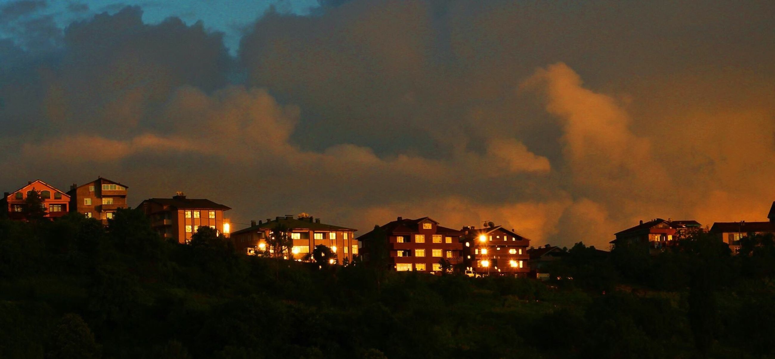 building exterior, architecture, built structure, illuminated, sky, sunset, house, residential building, residential structure, tree, city, dusk, night, cloud - sky, residential district, outdoors, no people, orange color, nature, town